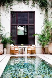 The colorful tile at the bottom of this dipping pool makes it look like a  work of art. It is the perfect focal point for this otherwise simple patio.
