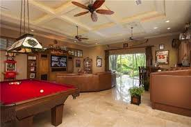 red pool table calling back the vintage popcorn machine and curved brown leather sofa with off