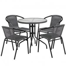 skovde 5pcs round 28 glass metal table w 4 gray rattan stack chairs