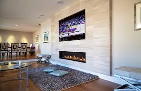 the ortal modern fireplace is a front facing and glass fronted fire that can be beautifully integrated into walls and architectural elements