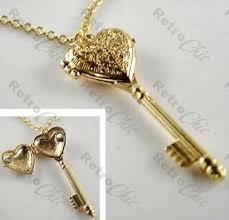 ornate key locket pendant opens long