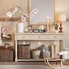 Cards and gifts are beautifully displayed alongside a large mirror and  classic cream console table in