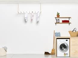 george and laundry rack in white laundry room