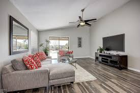 contemporary living room with high ceiling flush light 54 stealth dc 5 blade