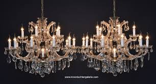 a pair of two large crystal chandeliers with 16 light 0