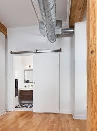 contemporary barn door in white for the industrial bathroom design rad design