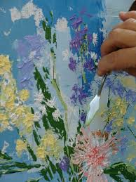 tisha wood using a palette knife to paint in acrylics