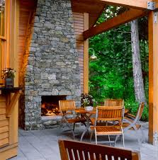 fireplace stone outdoor house wall mounted on concrete deck standing
