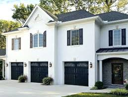 grey house white trim white house black windows how to paint a garage door in 7 simple steps grey house white house grey house white trim red door