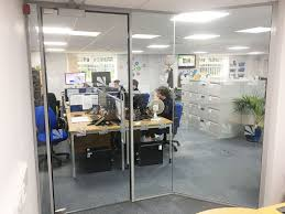 glass door office. From Glass At Work: Faceted Office Partition With Frameless Door For Daly Systems D