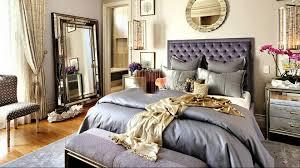 simple master bedroom ceiling lighting ceramics flooring large grey rugs grey bed dark finish wooden base