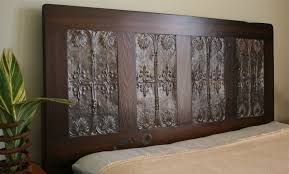 Queen Headboard Made From Reclaimed Door and Paired with Victorian Ceiling  Tin. $700.00, via