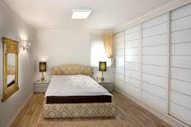 Sliding Closet Doors Bedroom Eclectic With Bedside Tables Brocade Closet.  Image By: Elad Gonen