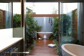... tranquil outdoor bathroom design with freestanding bathtub and wooden  pathway ...