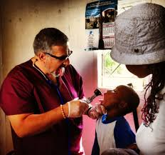 richard sartori of allied physicians group examining orphans for the richard m brodsky foundation