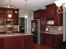 cabinet and lighting. Exciting Pendant Lighting With Dark Kraftmaid Kitchen Cabinets And Granite Countertop Plus Sink Faucet For Cabinet
