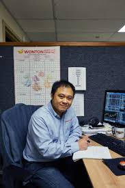 chinese new year go inside a fortune cookie factory com new fortune cookie writer james wong at his desk working wonton food inc