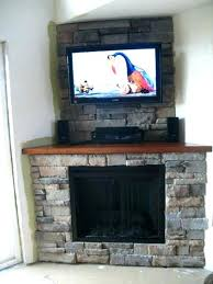 stone fireplace with tv above corner fireplace ideas with above simple design stone tile corner fireplace