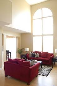 red and black furniture. working on this look for my living room red couch and chair with black furniture