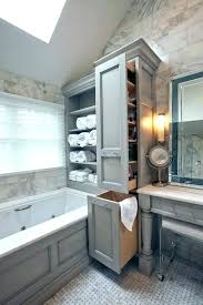 laundry hamper ideas for small bathroom open shelf storage above tub with pull out hamper cabinet