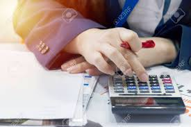 Salary Expenses Calculator Business Woman Is Calculating To Pay Expenses Use A Calculator