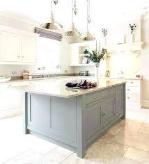 natural maple cabinets with black granite countertops white quartz