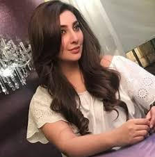 ayesha is wearing a simple top with her hair styled in her characteristic way with naturally toned makeup here are some shots from ayesha khan s caign