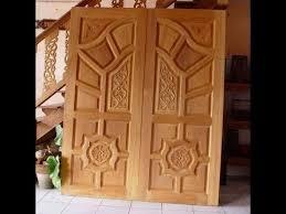 kerala style wood work front door designs 2