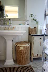 innovative kohler pedestal sink in bathroom farmhouse with pedestal sink next to above cabinet alongside bathrooms and painting wood paneling