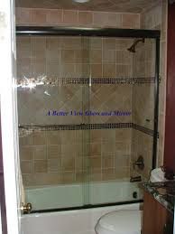 shower enclosure with brushed oil rubbed bronze semi frameless glass sliding glass bypass doors available to order from a