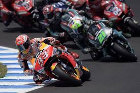 repsol honda teams spanish rider marc marquez leads the race after the start of the motogp