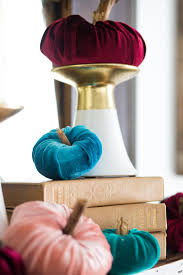 trace a circle onto the second piece of velvet fabric large enough to cover the cotton batting pumpkin repeat the previous steps with the fabric and the