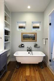 used clawfoot tub bathroom farmhouse with artwork baseboards storage built in shelves faucet menards