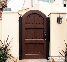 Spanish Style Wooden Gates   Dynamic Garage Door   Designer ...