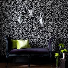 ... Julien Macdonald takes a classic animal print and gives it a modern  twist in black and white, for a zebra-effect designer wallpaper that will  look ...