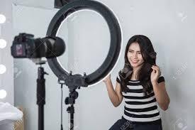beauty ger makeup tutorial video concept portrait of asian woman showing makeup