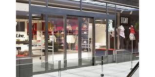 assa abloy sl500 frame sliding door system in a ping center