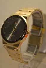 black and gold watch gold and black dial men s watch q q by citizen elegant