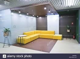 office reception interior. Interior Reception In The Modern Office Of Business Center. Yellow Corner Sofa Reception. Exit Office. A