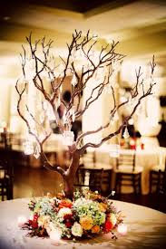 Beautiful tree centerpiece with hanging crystals by Hydrangea Floral maybe  cream flowers or if possible to. Tree Branch CenterpiecesCrystal Wedding ...
