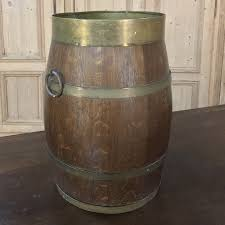 antique wooden wine barrel with brass hoops