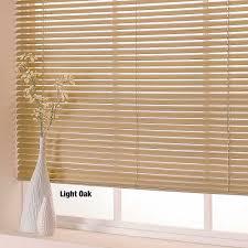 interesting cream wall with lovely light oak horizontal venetian blinds for interior design ideas