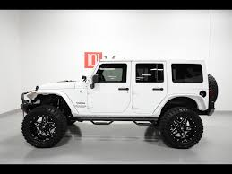 jeep wrangler 2015 white 4 door. 2015 Jeep Wrangler Unlimited Sport Photo Tempe AZ 85281 To White Door