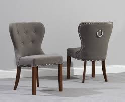 ring dining chair pair of kalim grey linen dining chairs with chrome back rings dark
