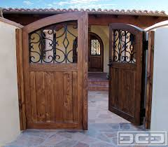 wood garage door builderSpanish Style Wooden Gates  Dynamic Garage Door  Designer