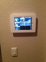 brad s ipad wall mount installation with mounted ipad and surveillance app running