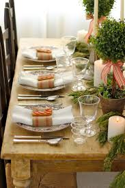 LOVE this Christmas TablescapeThe place settings, centerpiece, rustic  table create a truly warm inviting atmosphere for dinner with family  friends.