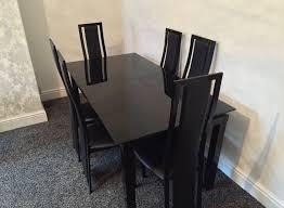 extending black glass dining table and 6 chairs set harvey s noir range black glass extendable