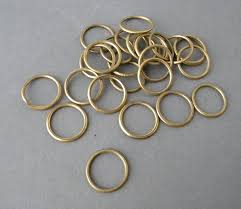 set of 26 antique curtain rings