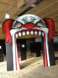 Spirit Halloween clown entrance. Wish I had one of these for the mouth of  my garage. If Spirit Halloween had any extras laying around, I'd even tak
